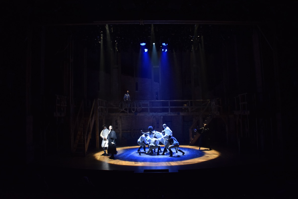 Circular storytelling and movement is incorporated into the set with a double turntable.