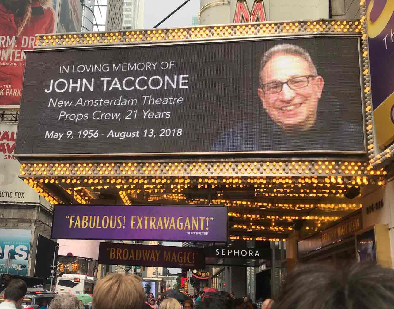 The Broadway marquee of the New Amsterdam Theatre with a tribute to IATSE Stagehand, John C. Taccone