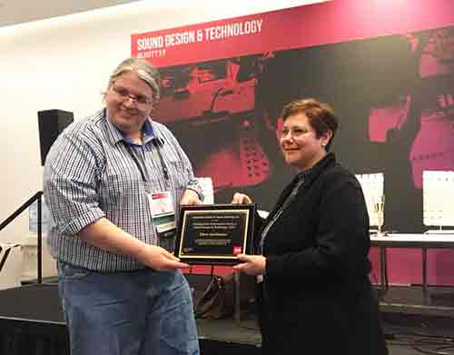 Erik Alberg, the USITT Sound Design & Technology Commissioner, presents Smitheimer with the USITT 2019 Distinguished Achievement Award in Sound Design and Technology Award. She is the the first woman to receive the award.