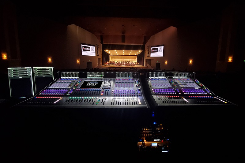 The Lake Travis ISD Performing Arts Center's FOH mix position is anchored by a DiGiCo SD7 Quantum desk paired with an EX-007 fader expansion unit