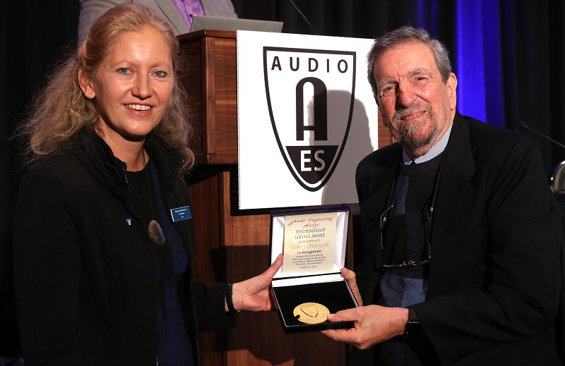 AES President Nadja Wallaszkovits with Distinguished Service Medal Award winner Garry Margolis on October 16 during the Opening Ceremonies of the AES New York 2019 Convention.