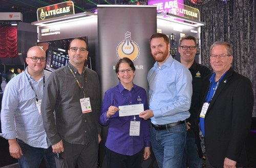 Pictured are (l to r) LiteGear's Mike Bauman, Al DeMayo, Mike Wagner and Paul Royalty presenting the check to Lori Rubinstein and Rick Rudolph (far right) form Behind the Scenes.