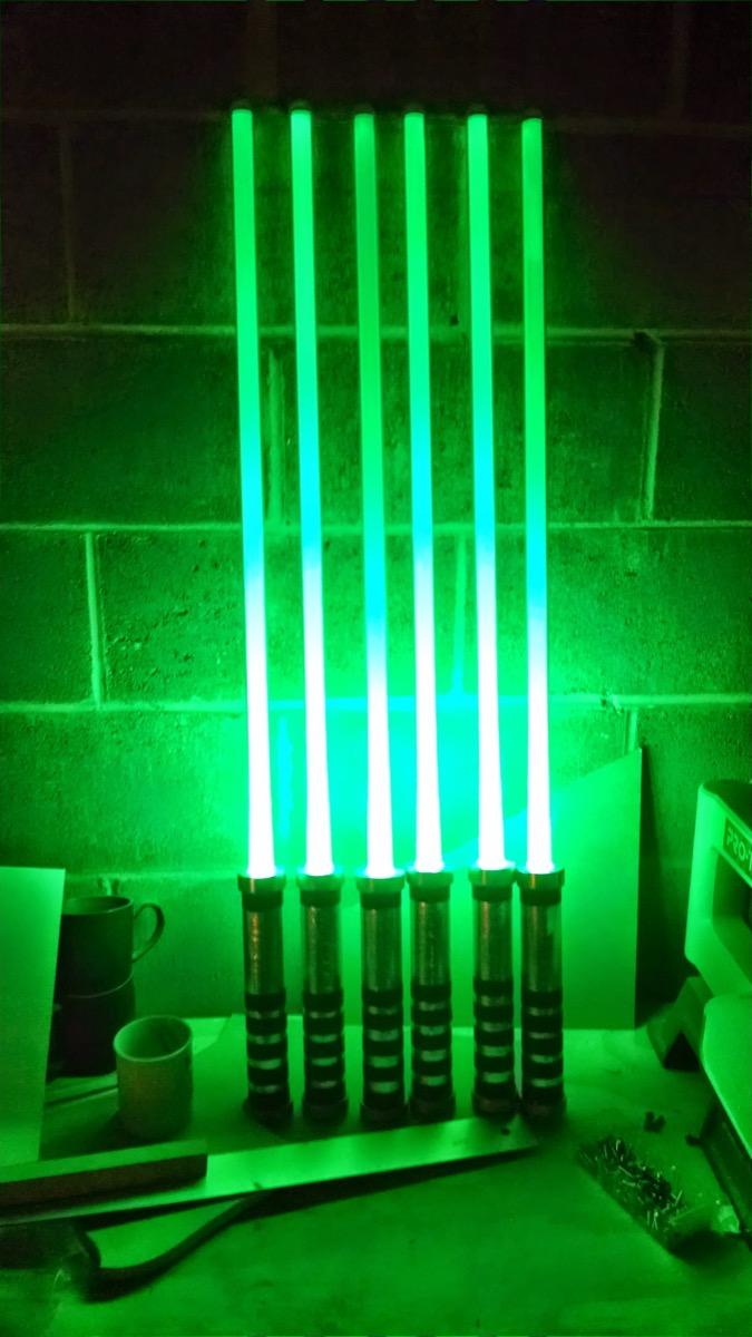 Darin Kuehler's LED lightsabers for a production of Enron.
