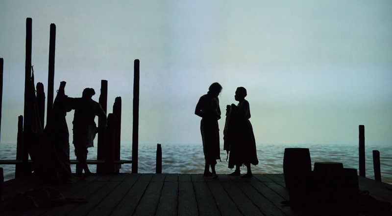 Dembi (Kimberly Scott), Cranston (Danforth Comins) and Adjua (June Carryl) on the docks of Bristol, RI, where the action of The Liquid Plain occurs.