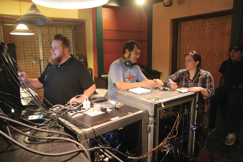 Sound designer E. Martin Gimenez, second from left, backstage at Invisible Cities.