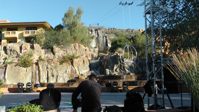 Flying By Foy suspended wires from the hills behind a resort into their pool area to fly in performers.