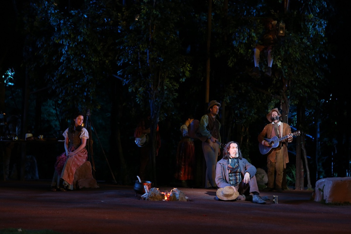 "A moment from Shakespeare in the Park's 2012 production of As You Like It, with a glowing bed of ""fire."""