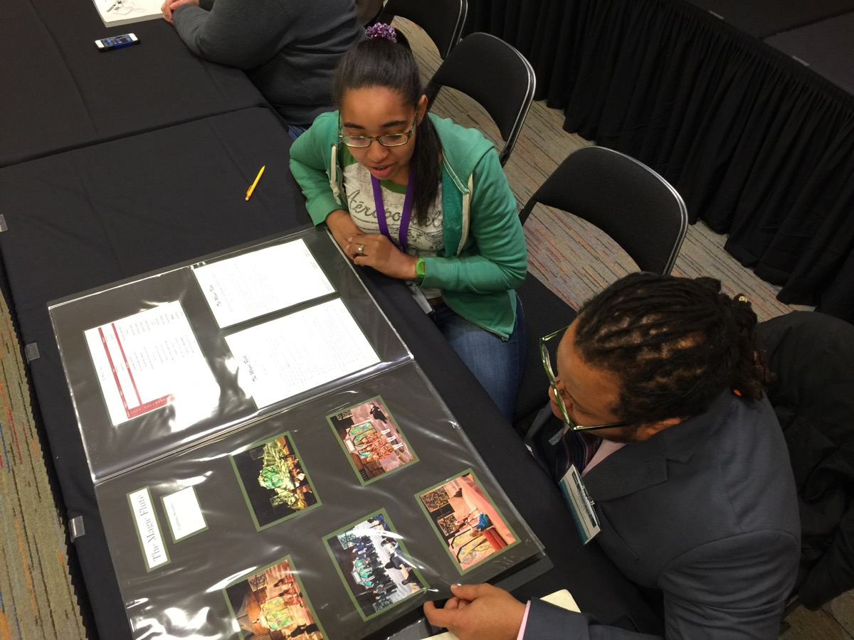 Terrence Spivey, artistic director of Karamu House in Cleveland (the oldest black theatre in America) gives portfolio advice to Jessica Drayton, a lighting designer studying at Wright State University as part of the Gateway program at the 2015 USITT conference.