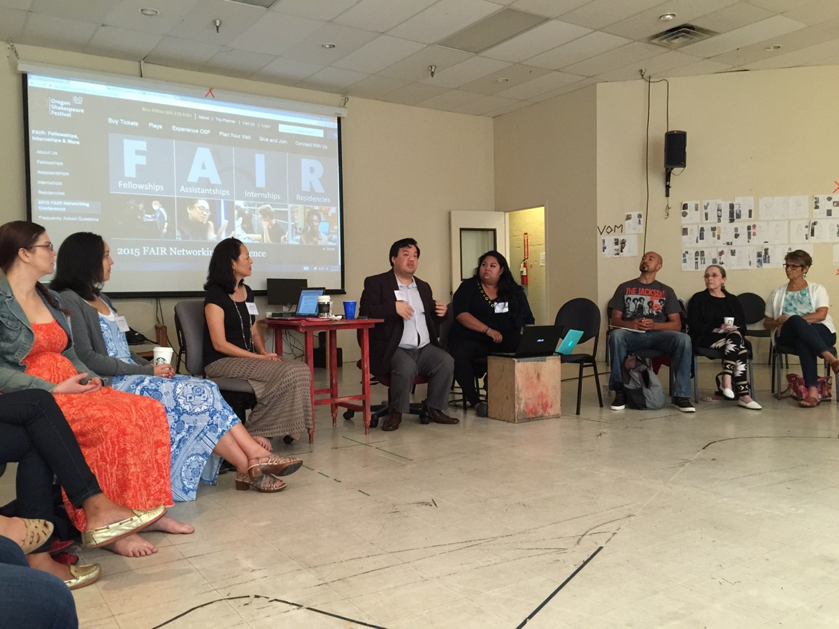 """Leslie Ishii, (FAIR participant in 2012/13, to the left of the table) and Peter J. Kuo (FAIR 2014, to the right of the table) speak about """"working from the outside, in"""" and how we utilize our individual and collective strengths in the industry at the 2015 FAIR Networking Conference at Oregon Shakespeare Festival."""