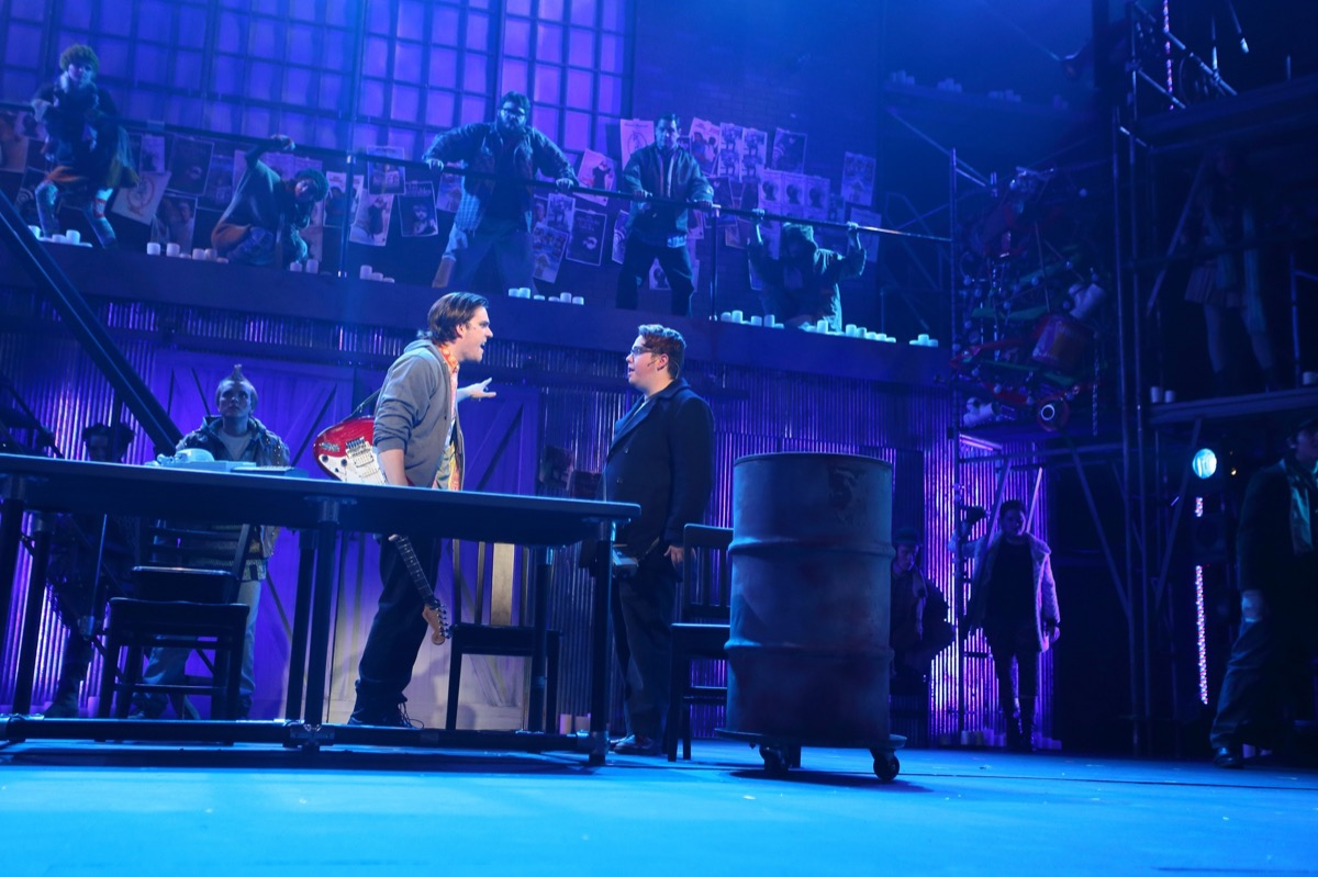 A moment from Rent at the University of Northern Iowa, lit with Elation Platinum Series moving heads and Colour Chorus Series LED battens. Photo by Roland Ferrie.