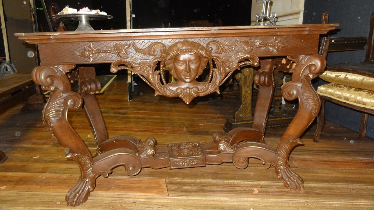 """The library table was bought to be used as a store display piece for a boutique in Salt Lake City. The store owners retired and felt that it and several other """"antique looking"""" pieces might be useful to the Utah Shakespeare Festival."""