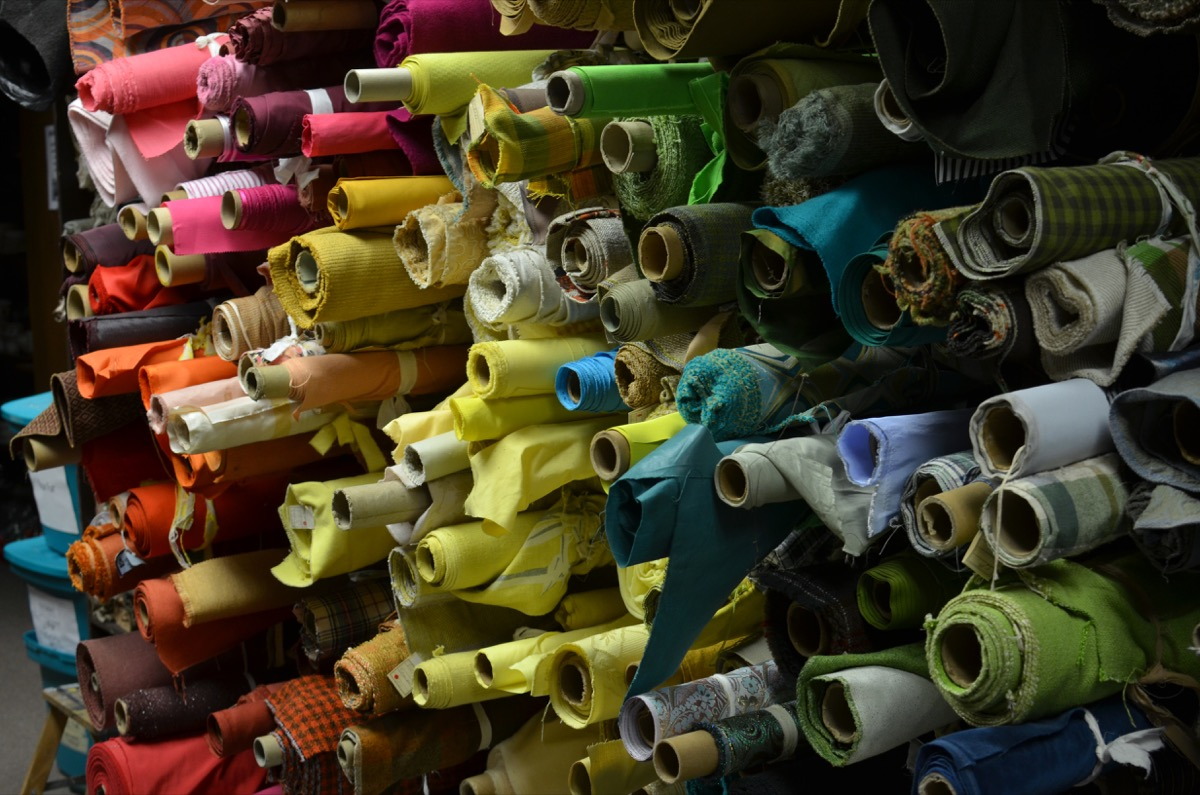 End rolls of fabric from local textile mills and upholstery factories fill the fabric storage area at Triad Stage.