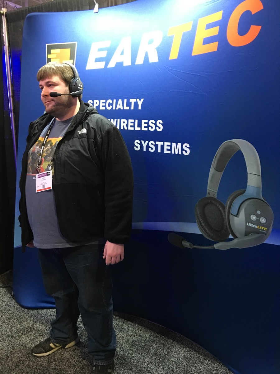 James Joseph of Eartec models their new UltraLite headset, which offers full-duplex comms for up to four headsets with no base station required.