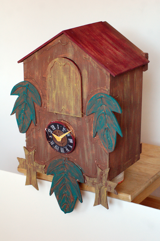 """The finished """"exploding"""" cuckoo clock in its ready state."""