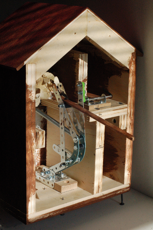 The back of the prototype cuckoo clock from Crazy For You, with a view of the Erector Set guts.