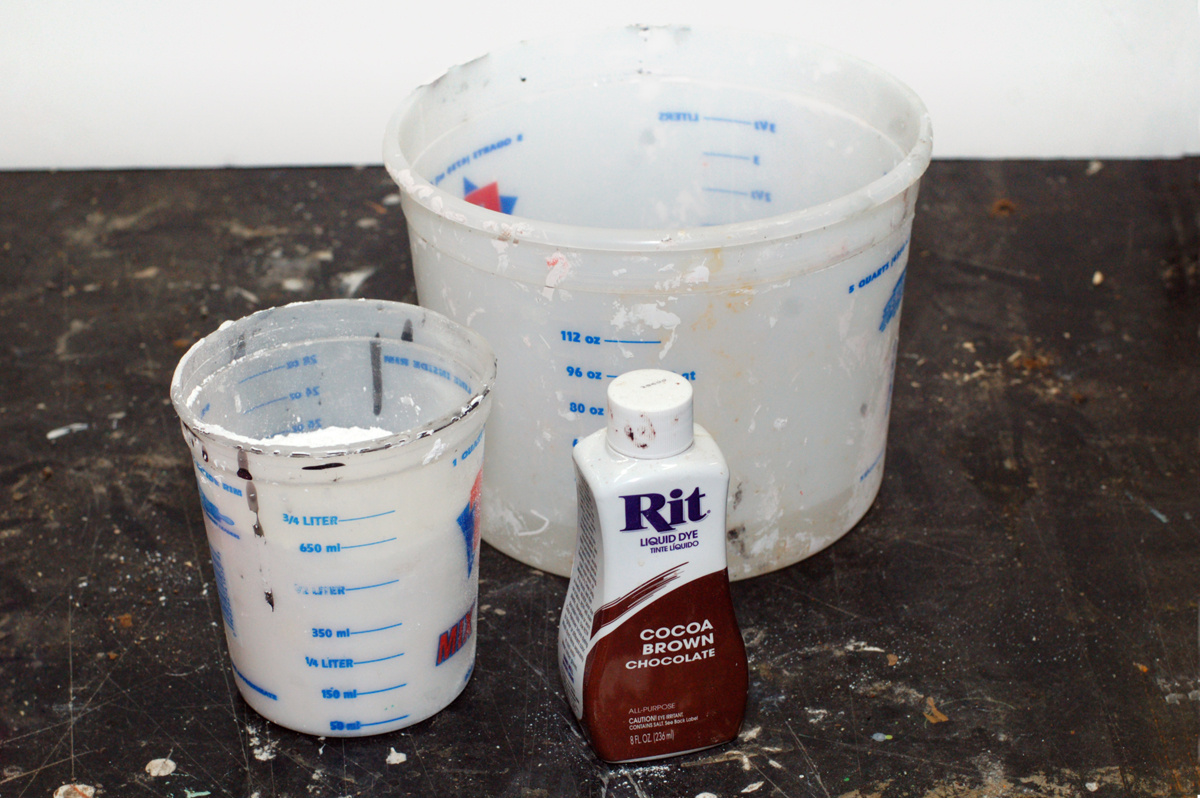 To make a plaster replica, you'll need plaster, water, and a little bit of brown dye.