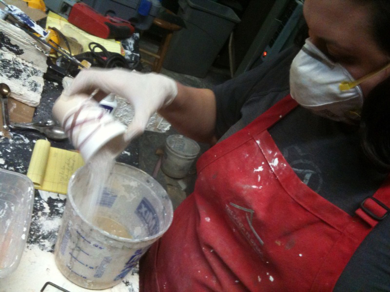 Always mix plaster into the water, and wear a respirator and gloves.
