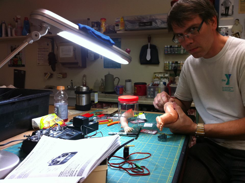 Jay Tollefsen at his workbench, prepping doll parts for the bloody baby-in-a-bag prop.