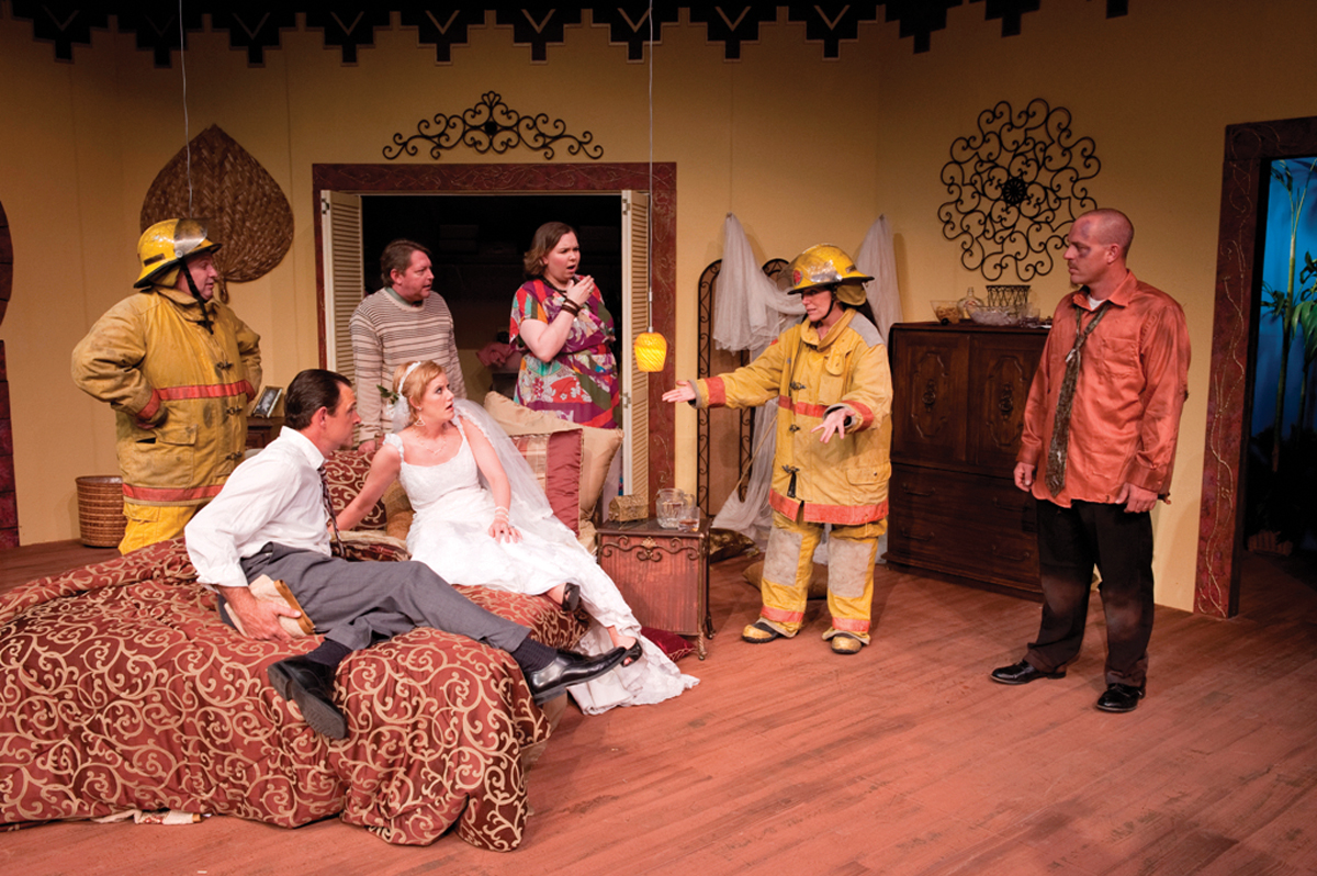 Left to right: Gary Hall, David Kloessel, Brittany Duncan, Diane Faulkner, Alan Roy and (on bed) Jennifer Odom and Paul Benson in a scene from the Midland Community Theatre premiere production of Knock Knock, by Patrick S. McLaughlin.