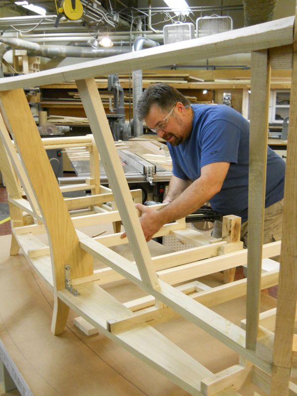 Erik Lindquist at work on a couch frame.
