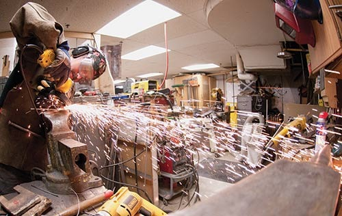 One of Tom Fiocchi's students learns metal working at the Ohio University props shop.