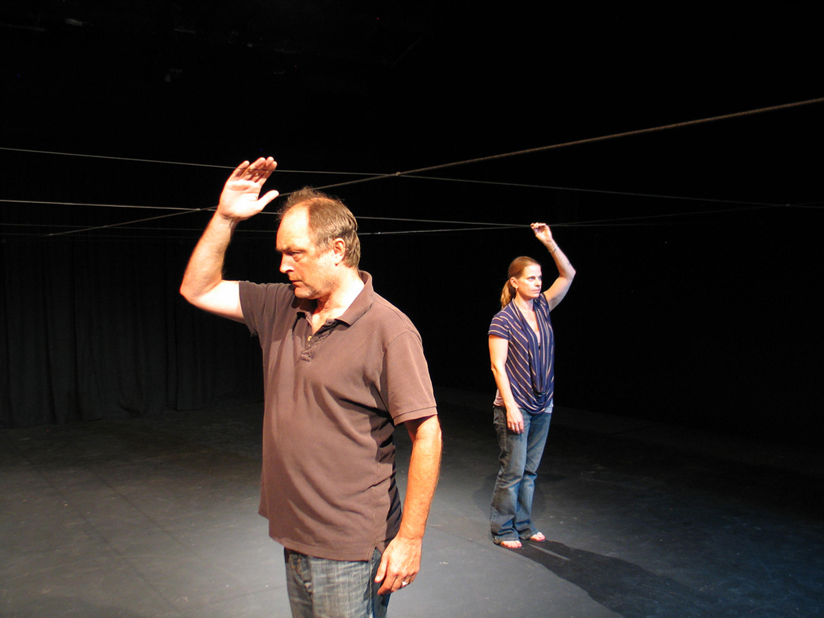 Actors Ron Bottitta and Kristina Lloyd find their way on the wire navigation grid during rehearsal for Odyssey Theatre Ensemble's Theatre in the Dark.