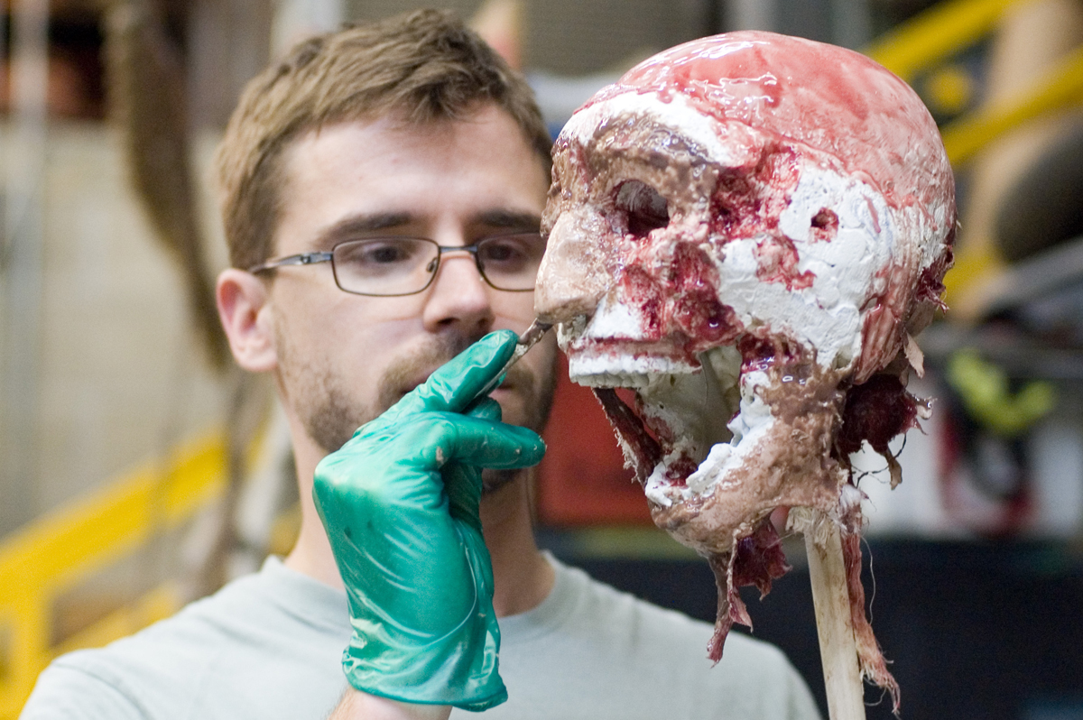 Eric Hart painting silicone onto a skull.