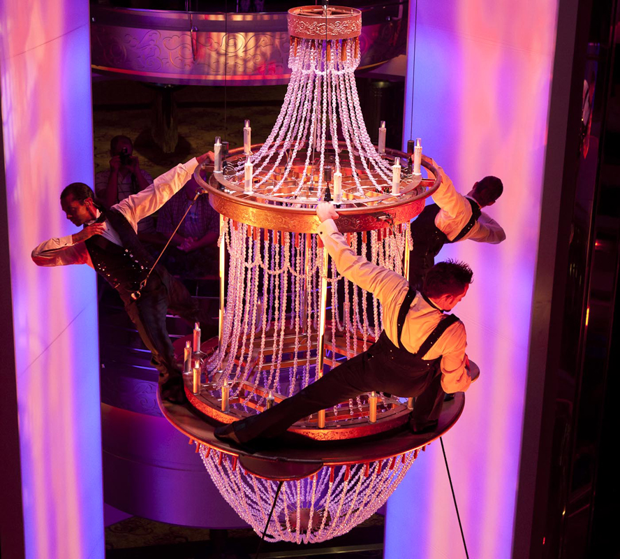 Rigging isn't just about holding up lights and scenery—Flying By Foy handles the rigging for hundreds of fliers a year, including this chandelier performance on the Royal Caribbean Cruise Lines Splendour of the Seas. Courtesy of Hariton/Baral Design