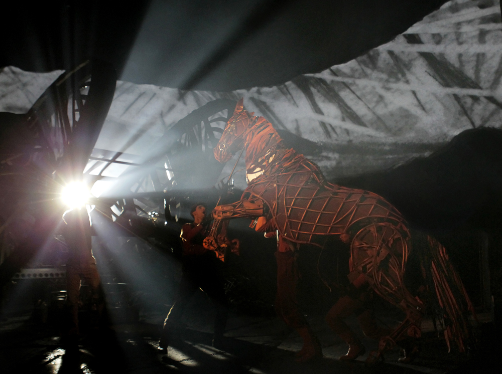 The lighting for War Horse was designed to emphasize the split between an idyllic home and the barrage of war.