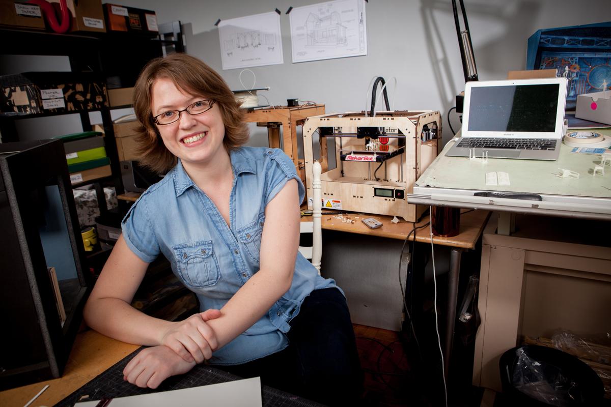 Kacie Hultgren, a scenic designer, with her Makerbot Replicator 3D printer